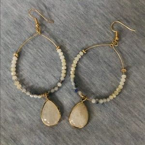 Beaded drop hoop earrings with a light pink stone